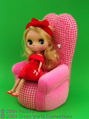 blythe sitting on a chair