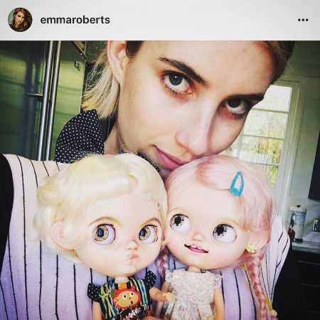 emma roberts posing with her new blythe doll